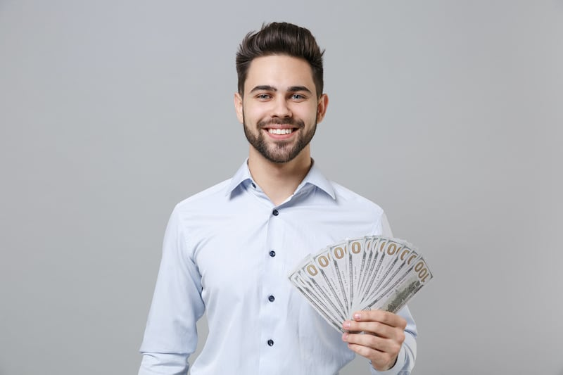 small business owner flashing cash