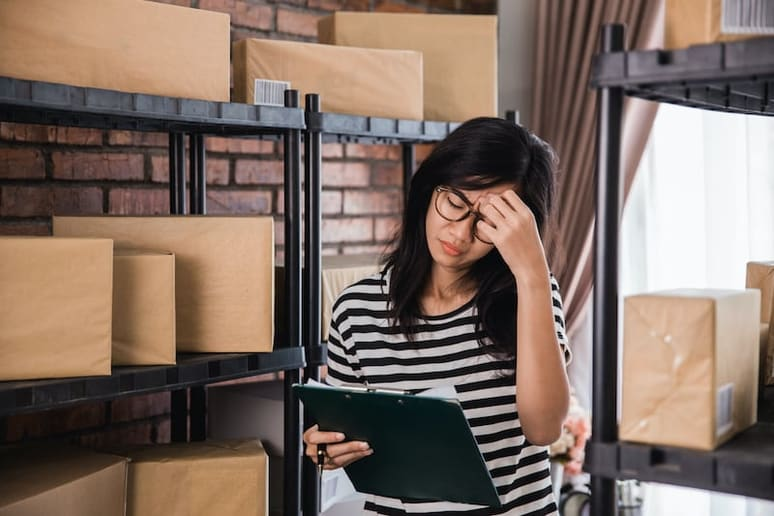 fleet manager frustrated when she checks schedule and sees problems with today's deliveries